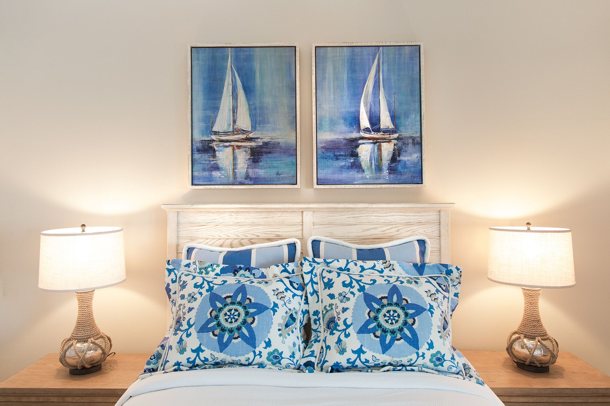 Nautical themed guest bedroom with white and blue decor