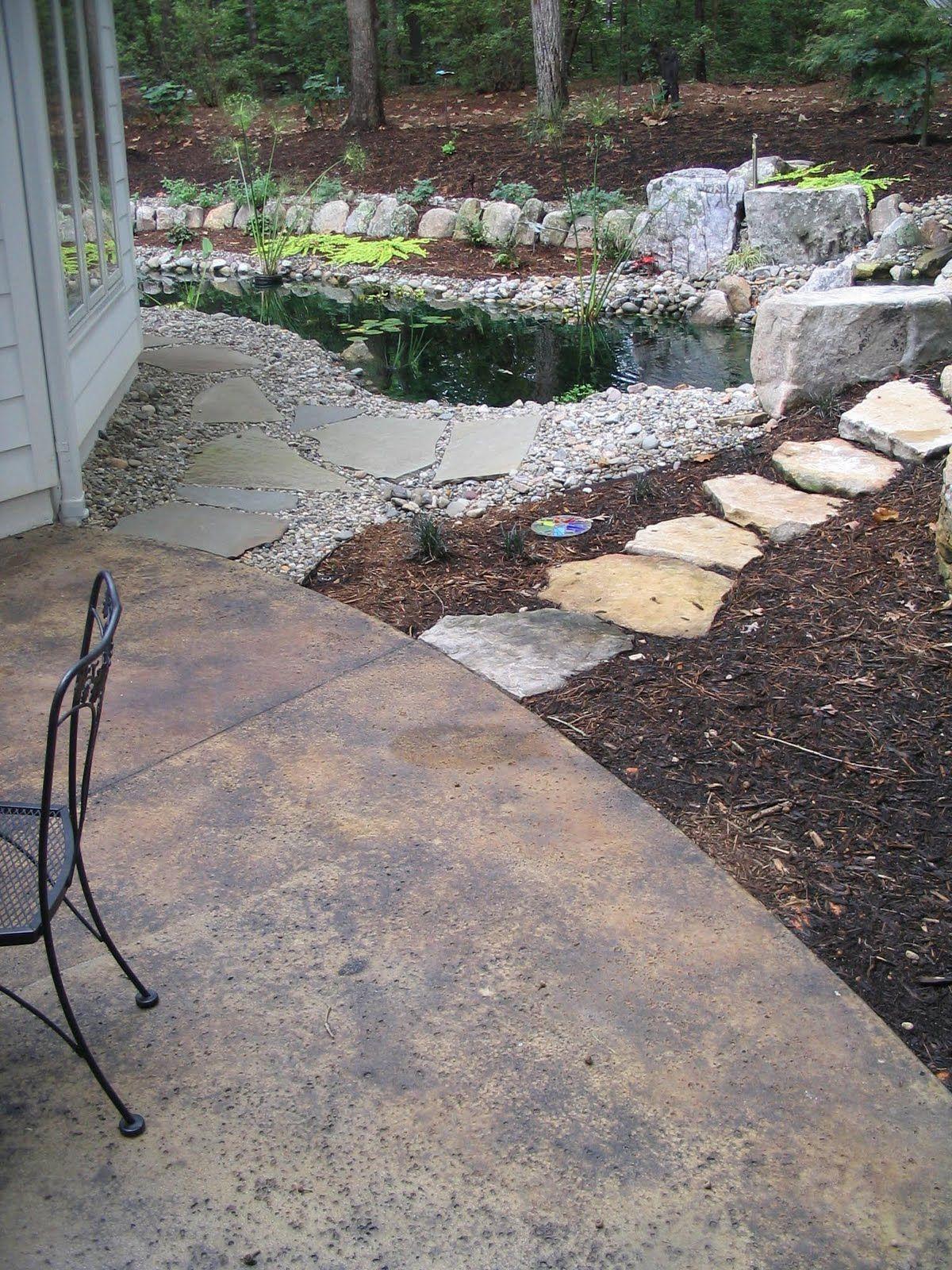 Poured concrete patio with rock salt finish acid stain 3 color