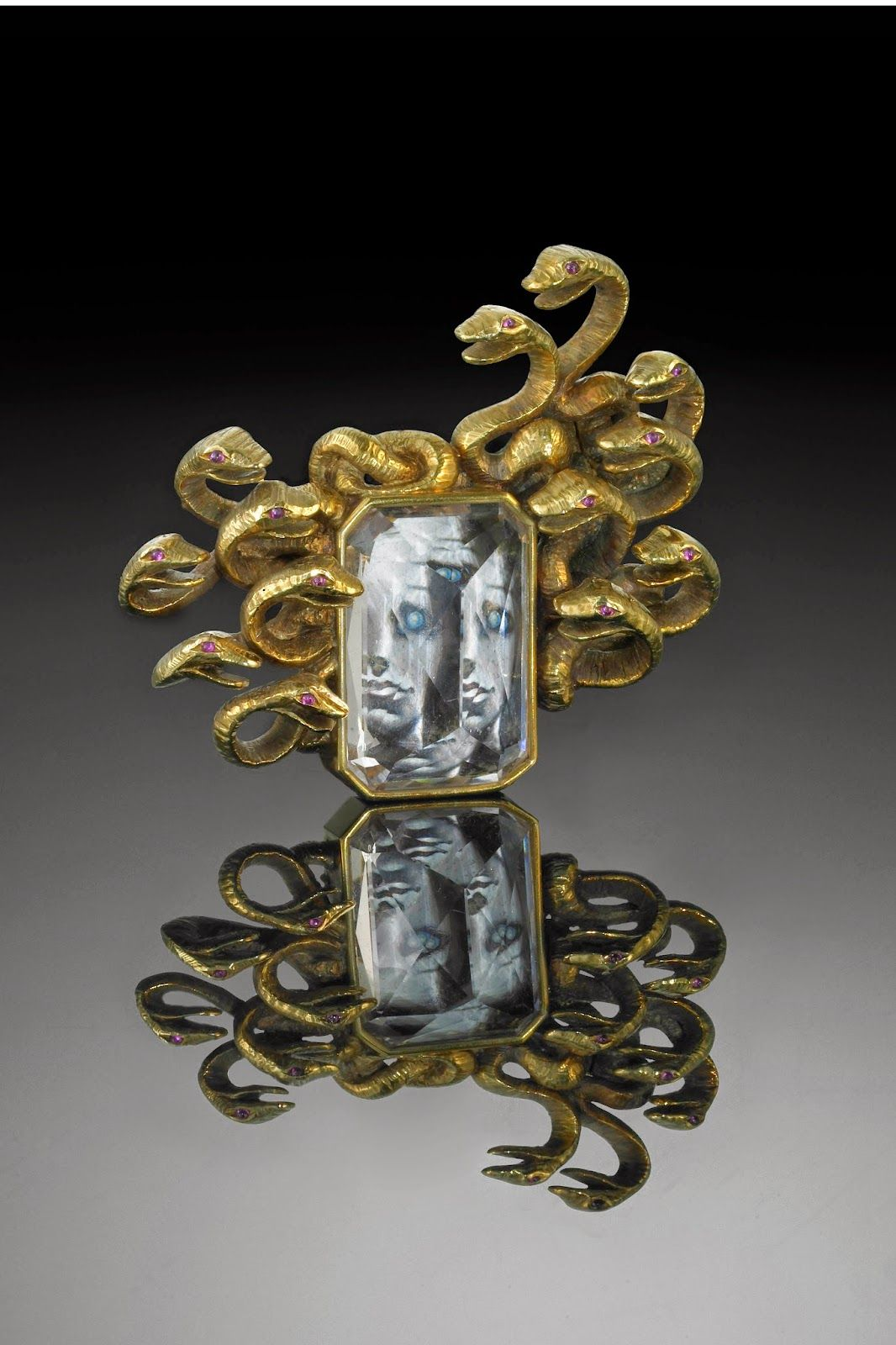 """""""Medusa"""" Brooch, created by Verdura in collaboration with Salvador Dalí, 1941. Made of gold, morganite and ruby, it frames a miniature painting  of Medusa by Dali. #VintageBrooch #Verdura"""