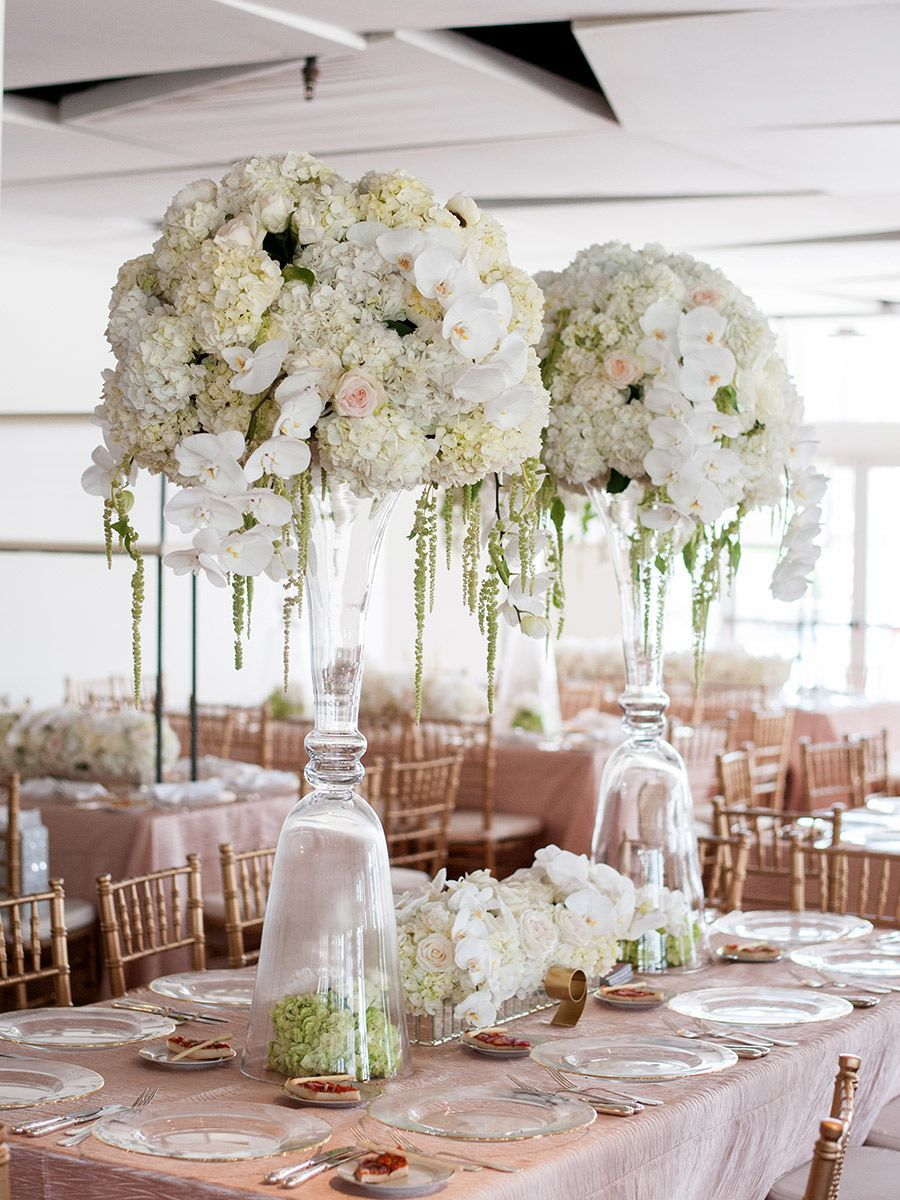 Tall centerpieces with orchids, roses and candles for wedding ...