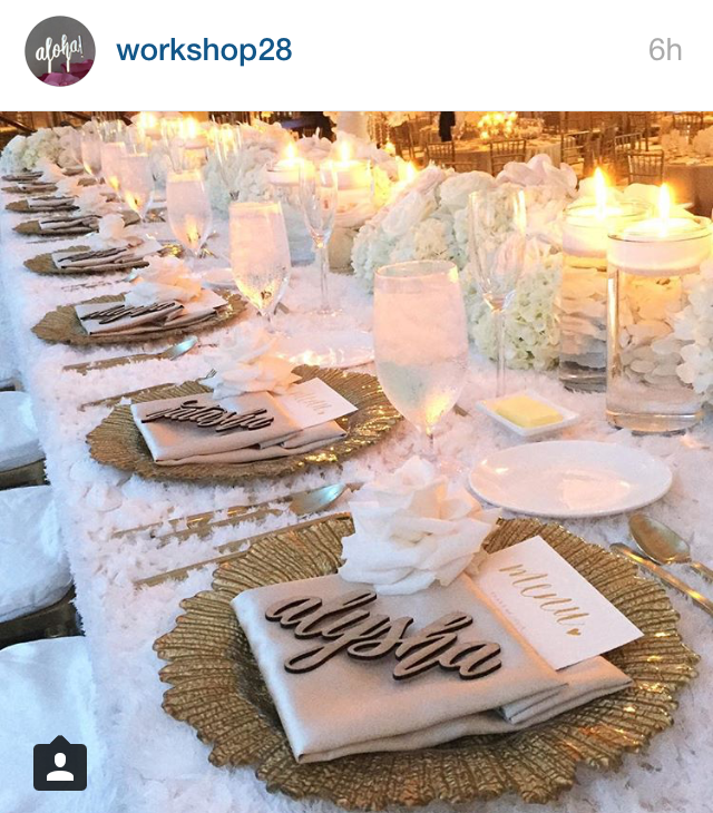 This placesetting is TO DIE! Gold charger, champagne napkin, laser cut name plates, menu insert with the font I love and a flower for the finishing touch! PLACESETTING for head table only!