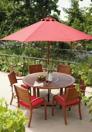 Warm Red Accessories Teamed With Wooden Garden Furniture Helps Create A  Mediterranean Feel In Your Garden