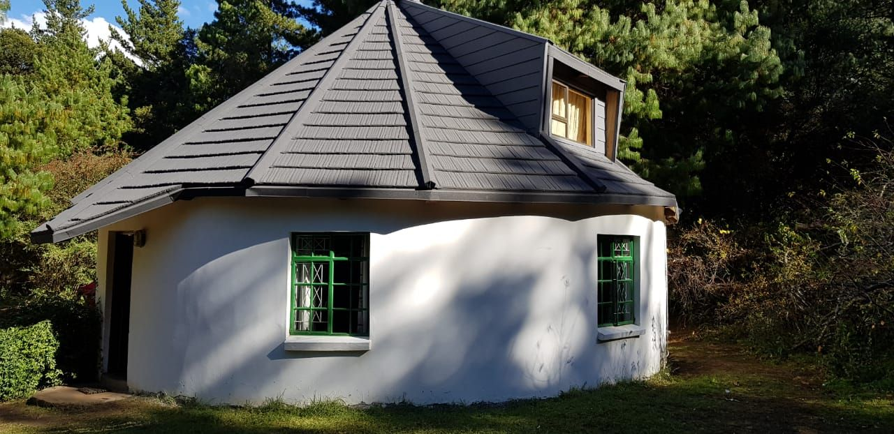 This Traditional Style Rondavel Or Roundhouse Was Converted From Thatch To Metrotiles Hogsback Eastern Timber House Building Plans House Round House Plans