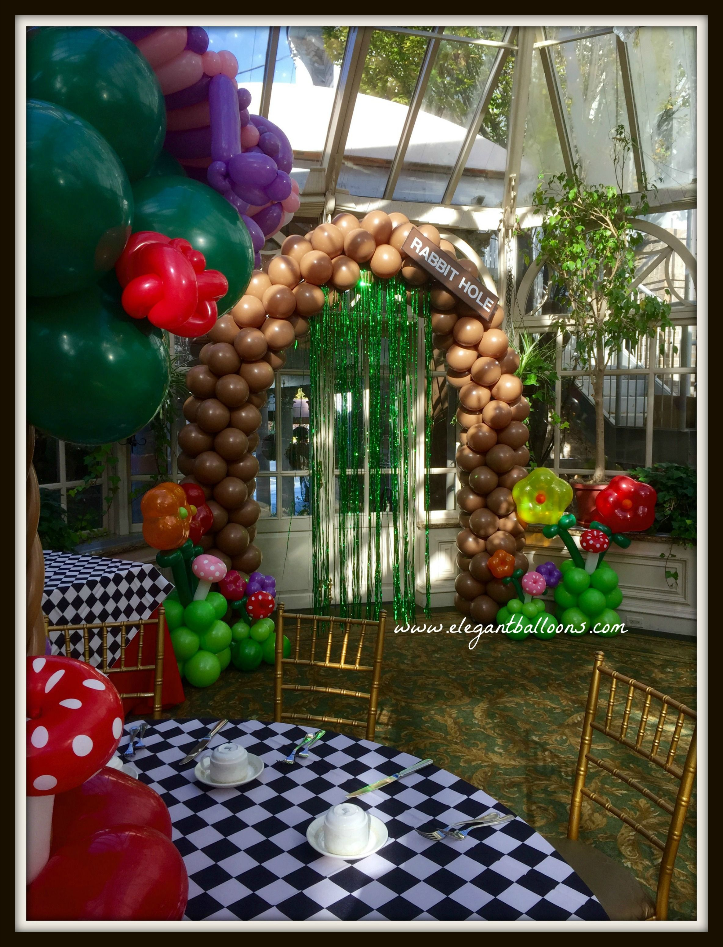 Alice In Wonderland Rabbit Hole Garden Party Arch #Aliceinwonderland #Elegantballoons