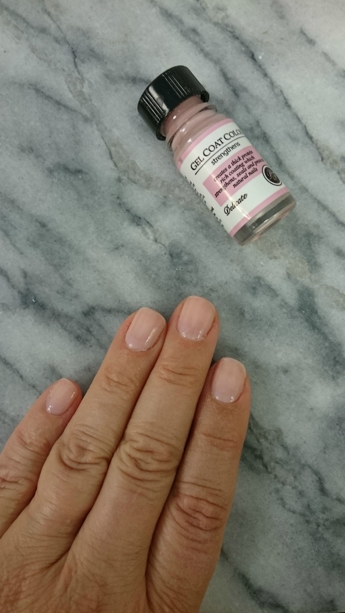 A Nail Strengthening Polish With Soft Opaque Neutral Pink Perfect Formula S Gel Coat Color In Delicate