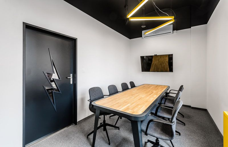 This new office interior uses wood and black frames to clearly define spaces