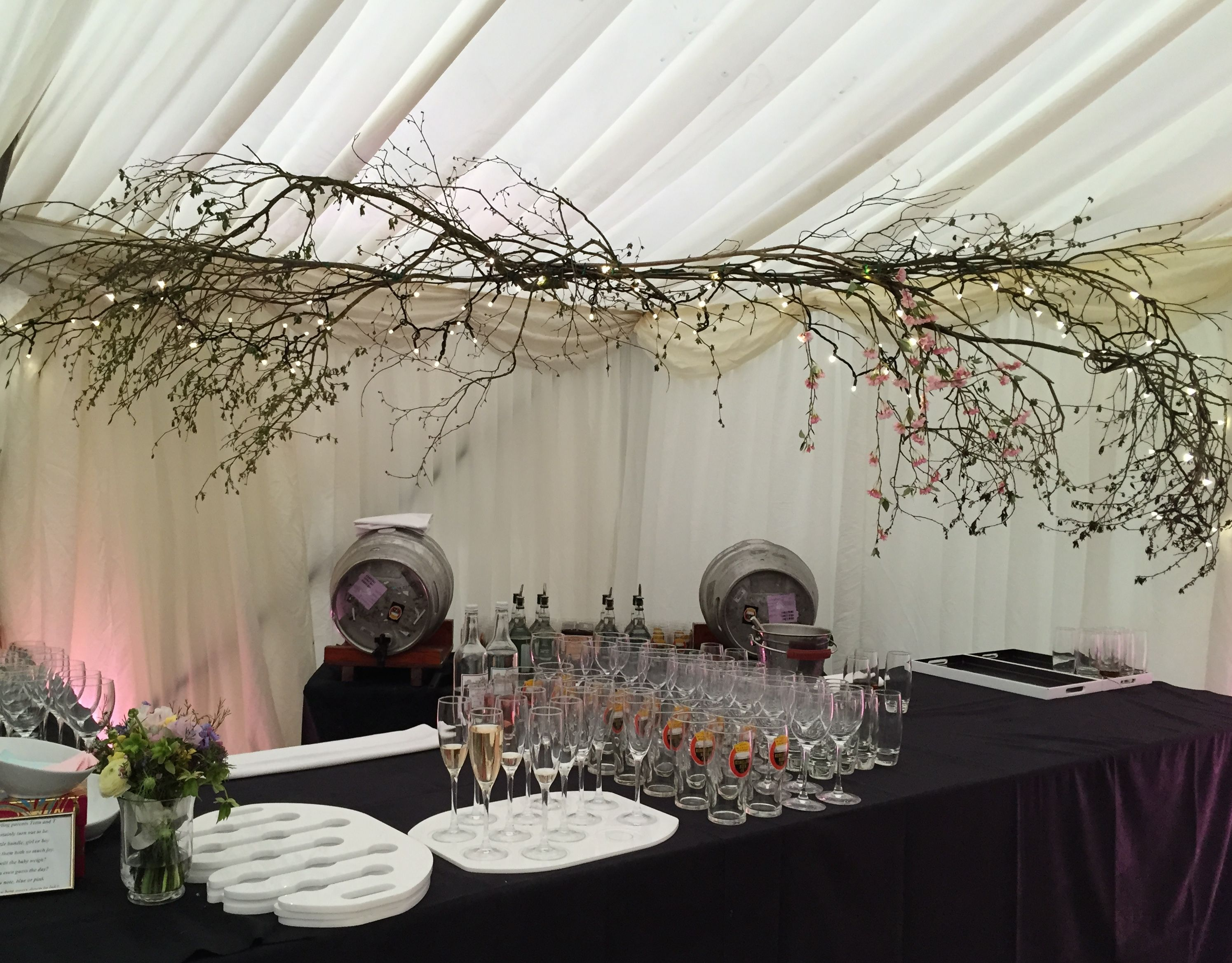 Spring blossom flowers decorating bar area in wedding marquee ...