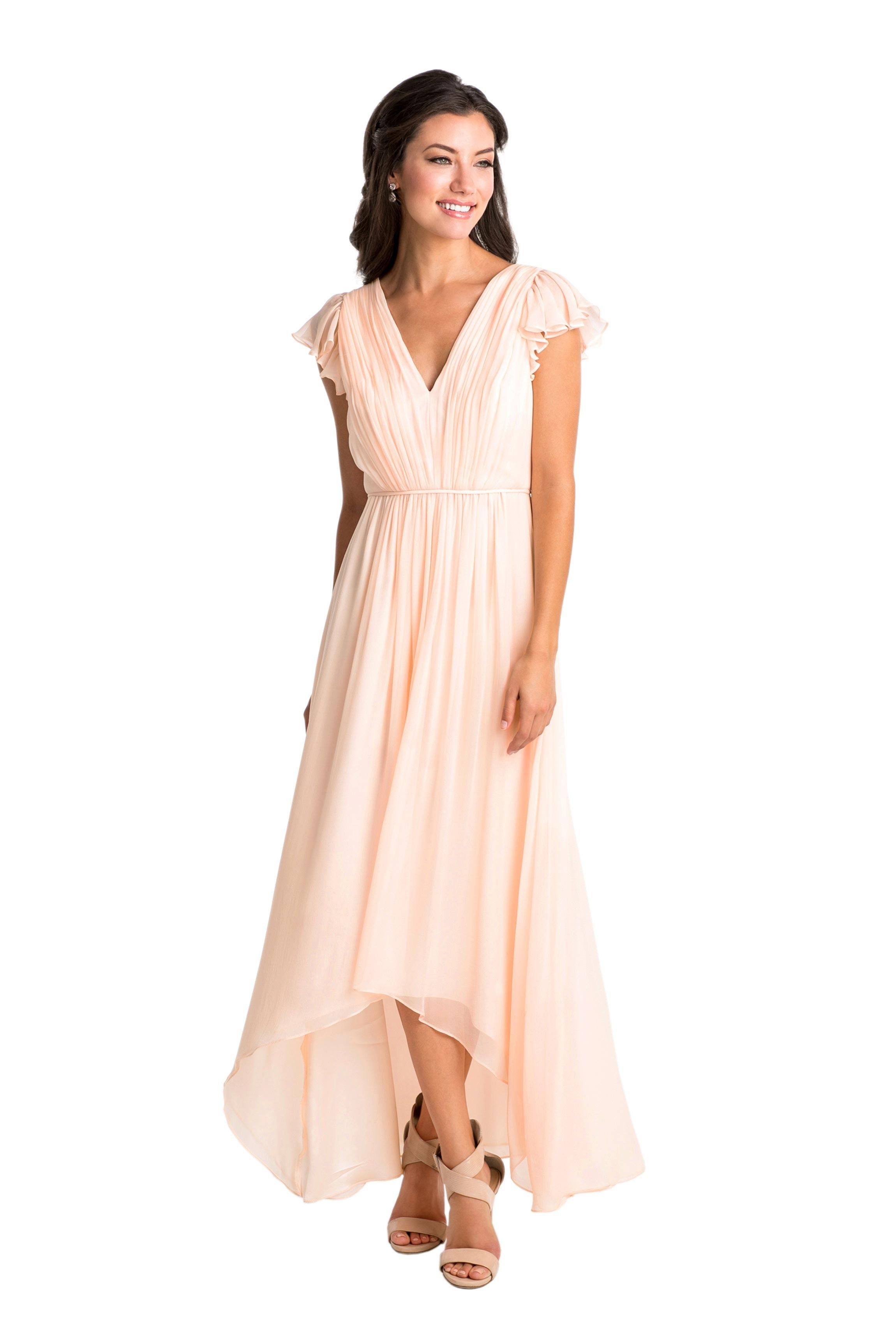 A long, chiffon blush-colored bridesmaid dress with flowing skirts ...