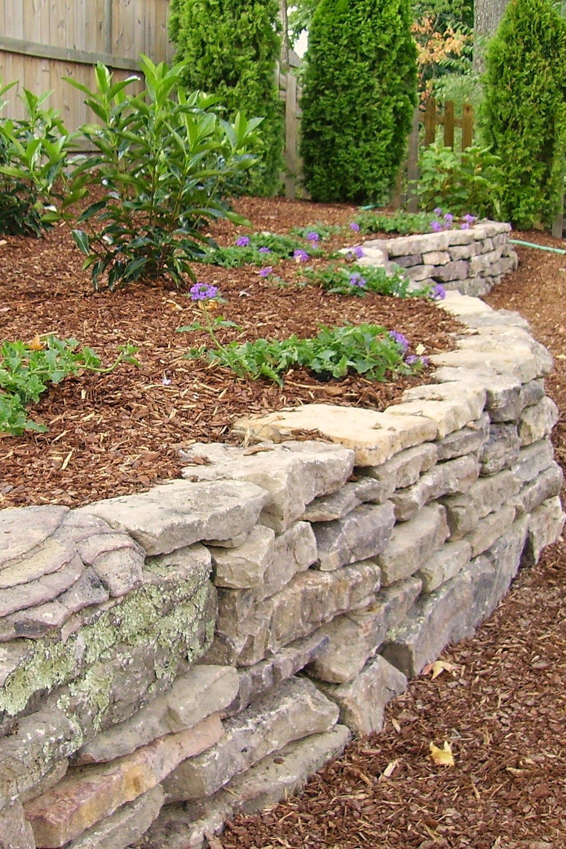 Dry Stacked Stone Another Great Way To Create Levels And Control Slope Issues Like Outdoor Dreams On Facebook For Garten Hochbeet Steinmauer Garten Garten