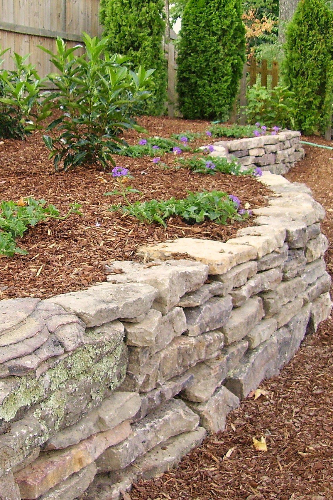 Dry Stacked Stone | Jardín con piedras | Pinterest | Dry stack stone on sloped vegetable garden, sloped raised flower beds, tiered garden beds, sloped landscape design, sloped garden design ideas,