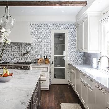 Charming Ivory Kitchen Cabinets With Gray Flower Mosaic Tile Backsplash