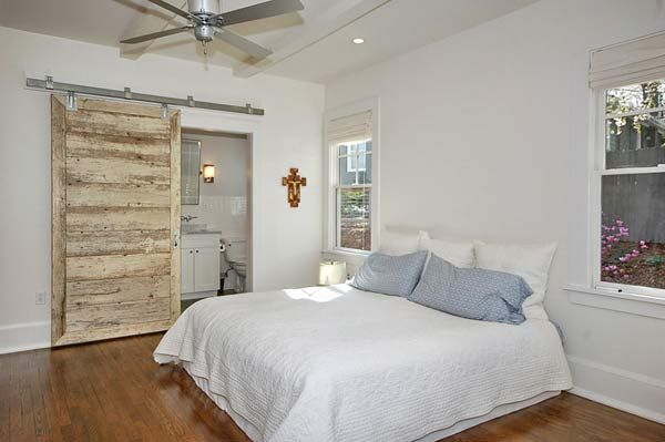 Here a barn door serves its function beautifully in this master bedroom.