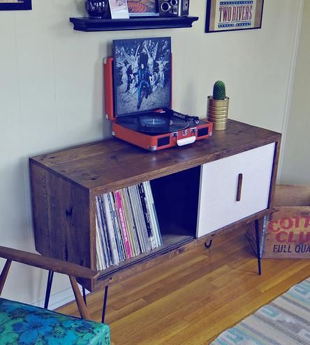 "Modern Arks made you a place to store even more of your records. This record cabinet is 42"" x 15"" x 29"" and features an authentic reclaimed barn-wood exterior with one white-washed sliding door. Store hundreds of your favorite LPs in this mid-century modern styled reclaimed wood storage piece. The Eames style hairpin legs complete the feeling of nostalgia while offering a truly one-of-a-kind finish. Sit your record player right on top--and turn up the tunes."