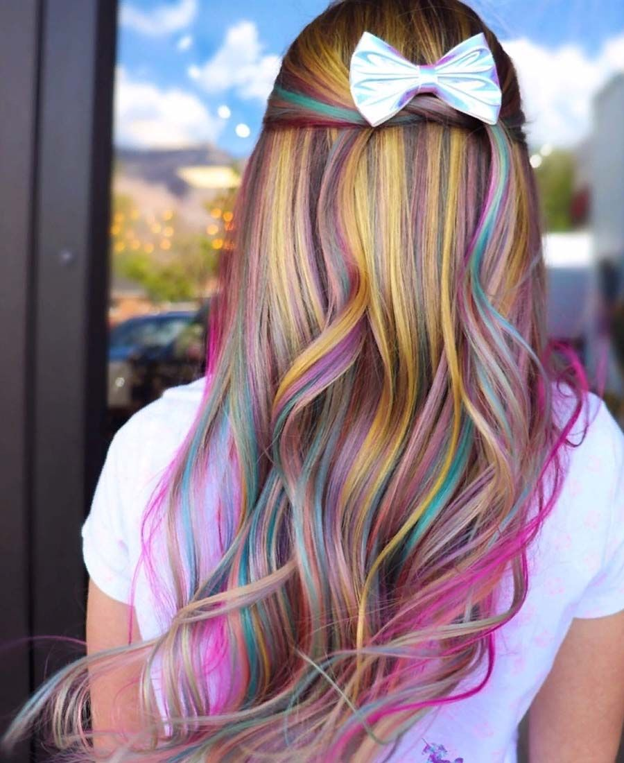 Blue Pink And Purple Peekaboo Highlights On Blonde Hair Kids Hair Color Peekaboo Hair Blue Hair Highlights