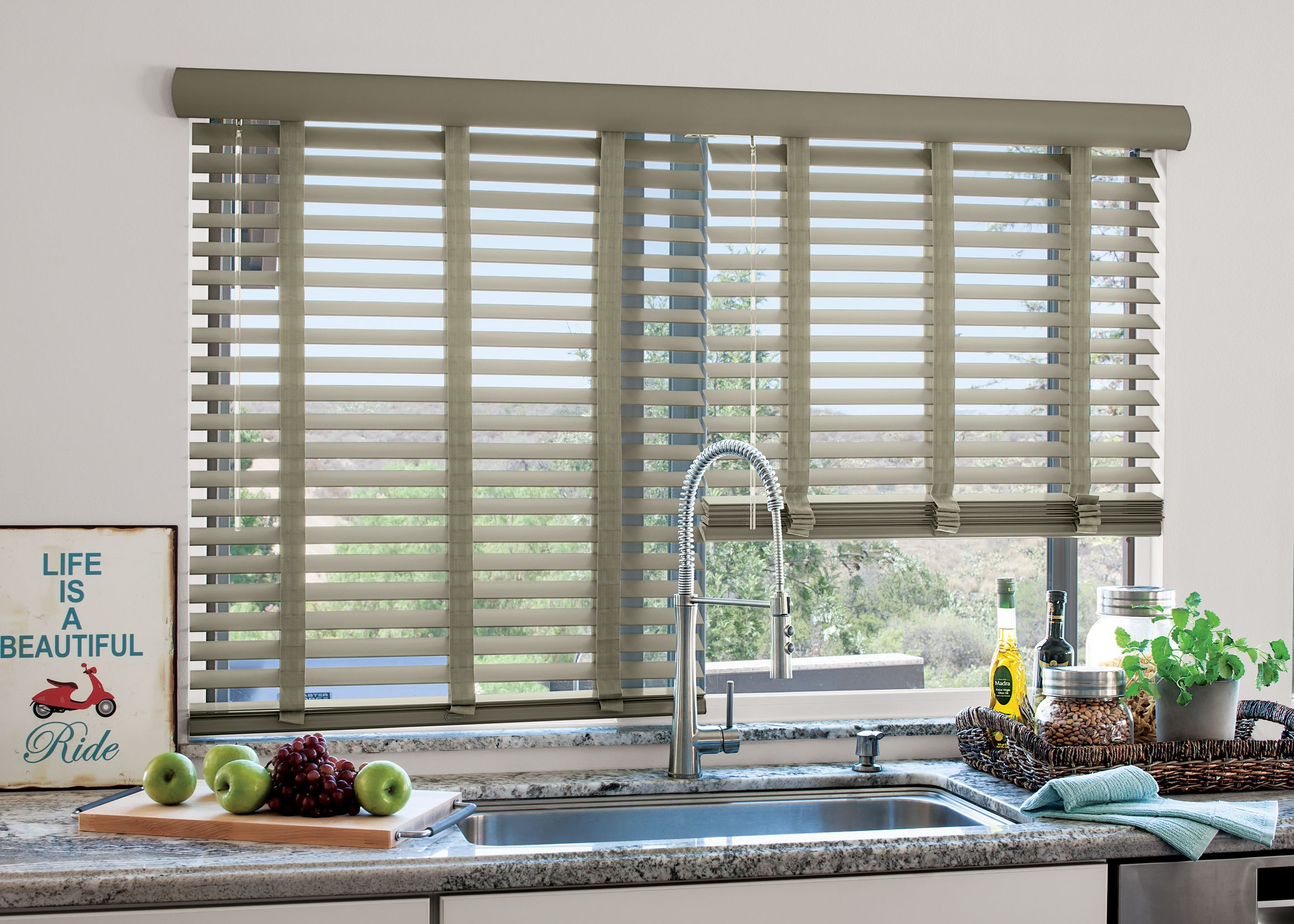 a beautiful wood blind in a gorgeous kitchen. #blinds