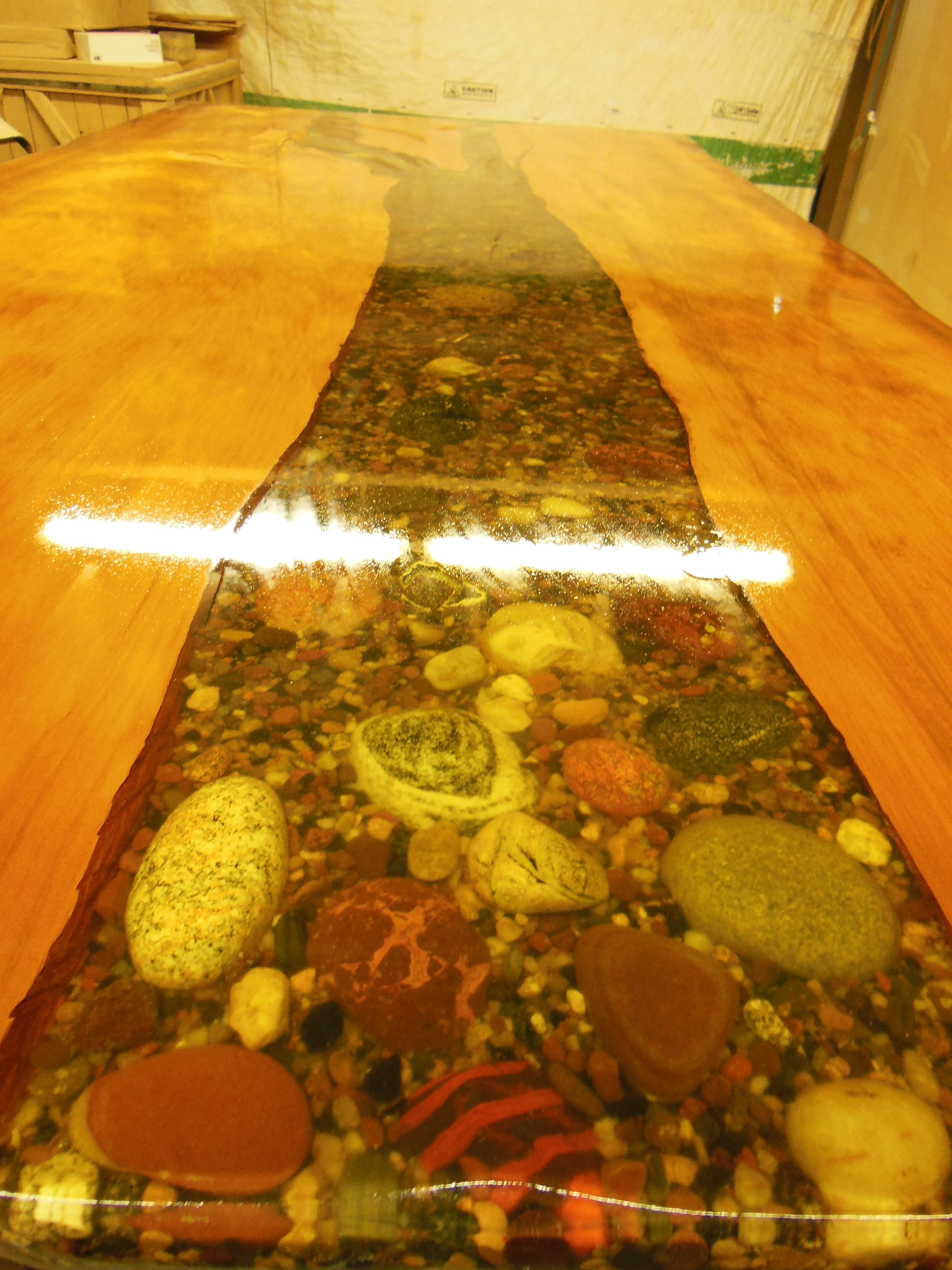 Ancient Kouri wood table with natural lake superior rocks set in epoxy.