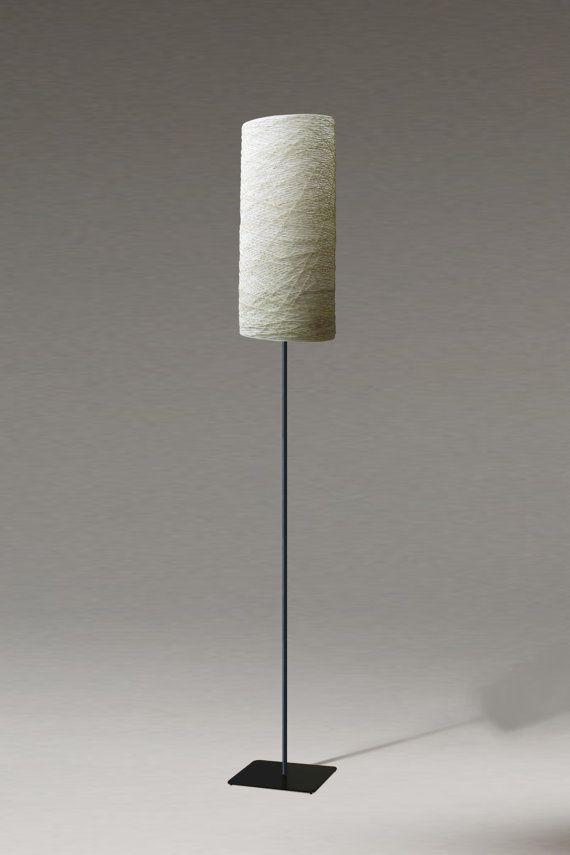 Lamp shade is made of linen twine in ecru and Japanese paper (leg lamp is a model hemma from ikea). The lamp itself is a intriguing decorative element,