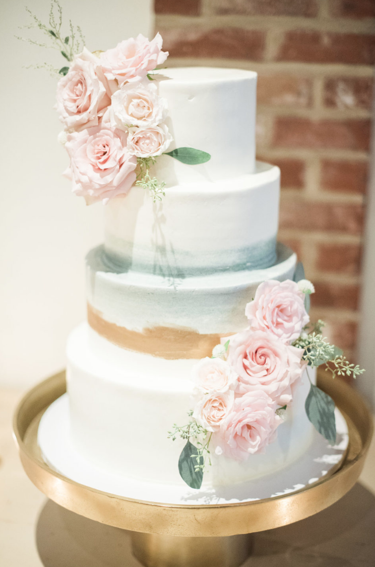 Four-tiered white wedding cake with pink rose decor at Cannon Green ...