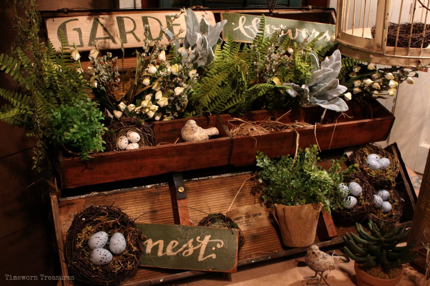 Old toolbox full of flowers, herbs, wooden signs, nests, etc. Spring ...