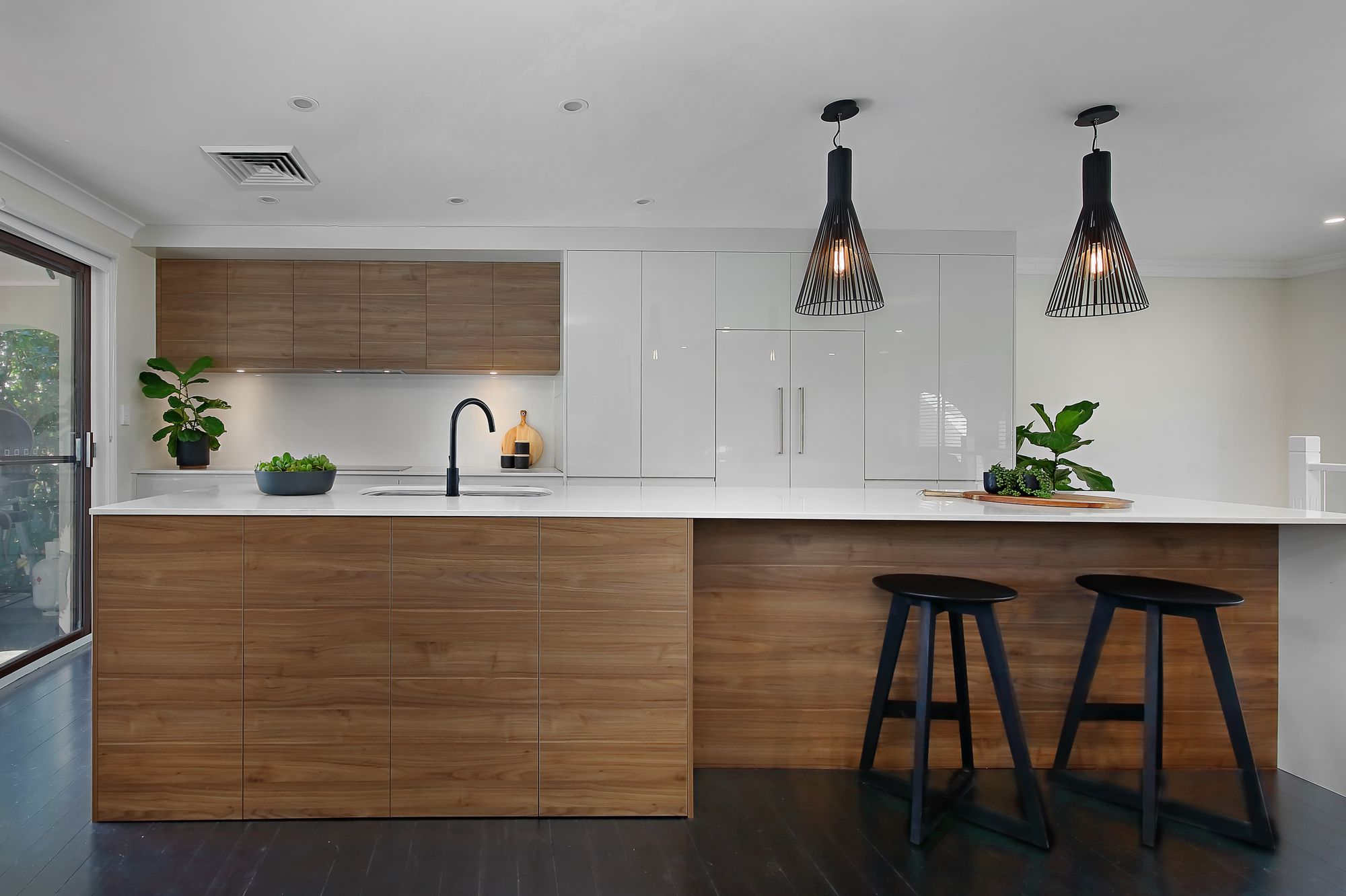 Caesarstone Organic White™ and timber accents create a ...