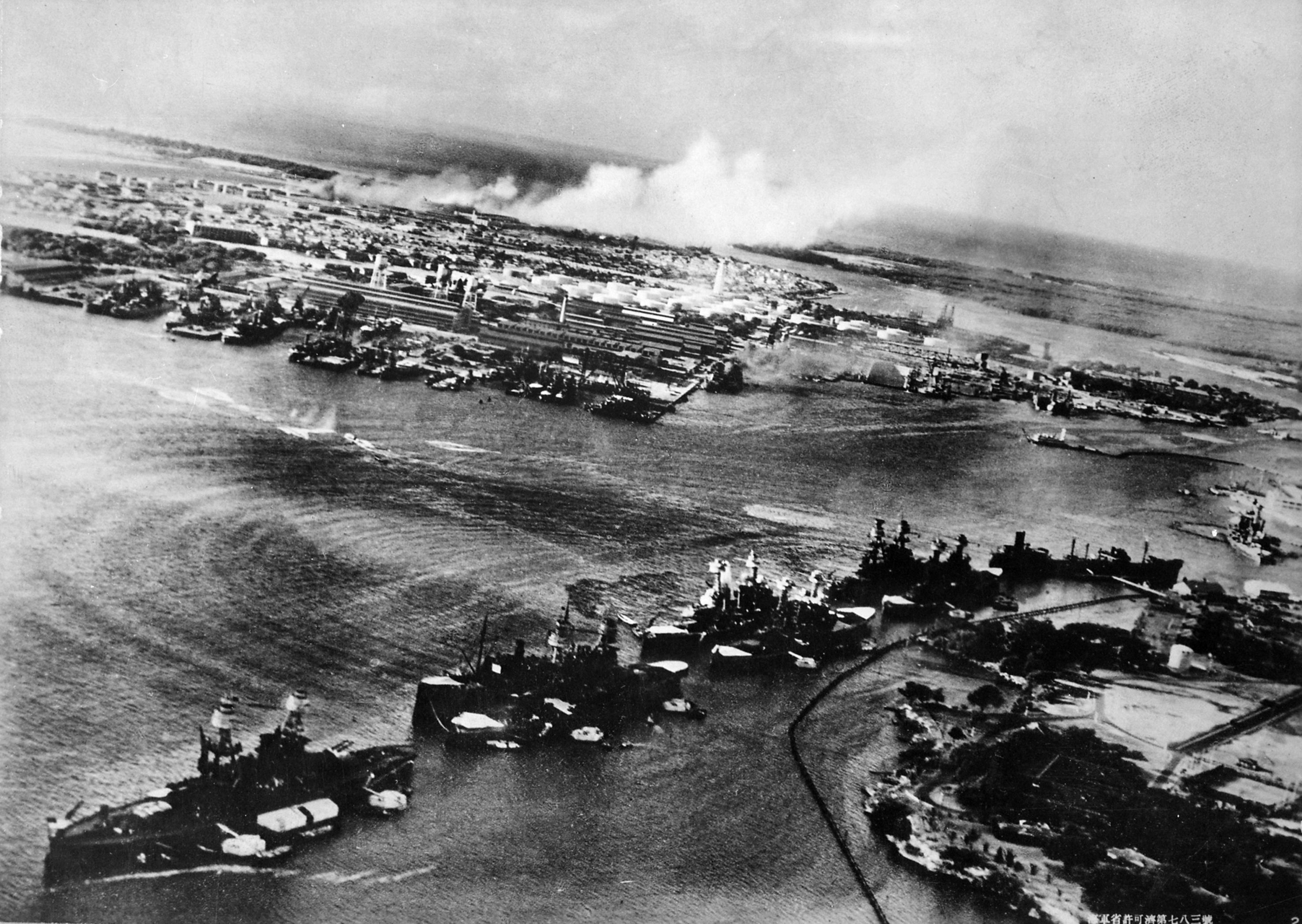 Attack on 'Battleship Row' of Pearl Harbor, seen from a Japanese aircraft, 7 Dec 1941 (US National Archives)