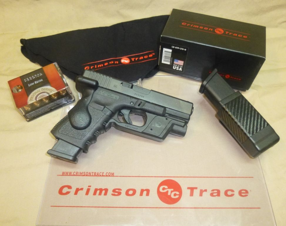 Crimson Trace LG-619 LaserGrip & LTG-736 LightGuard on a