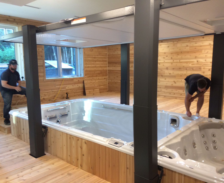 The Spa Shoppe crew installing a beautiful dual temp swim spa with ...