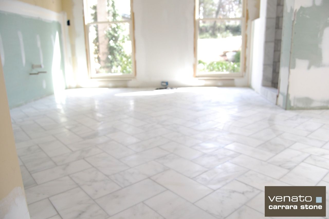 Carrara Venato 6x12 Marble Tile In The Process Of Being Installed