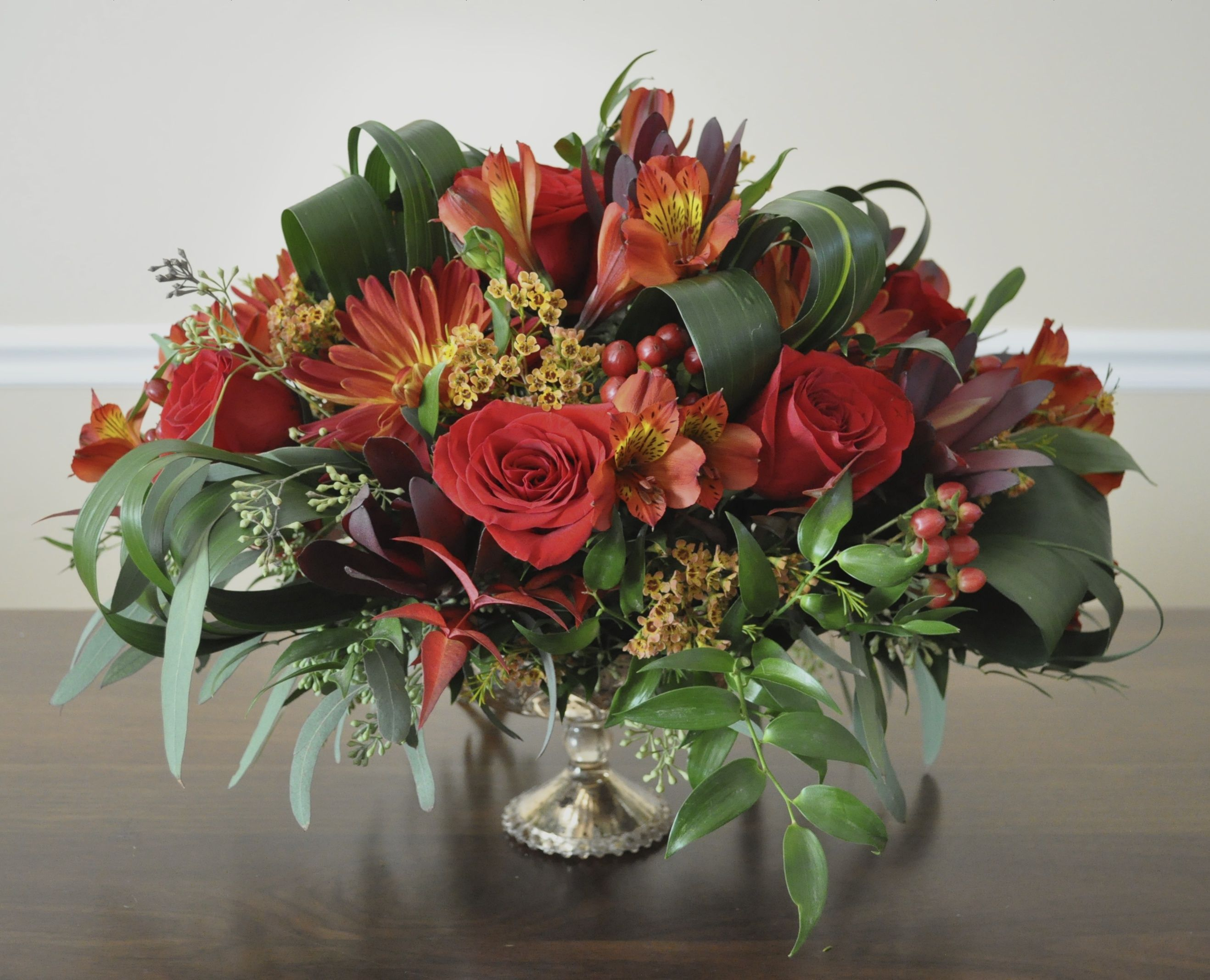 Holiday table centerpiece in green, red, light orange colors ...
