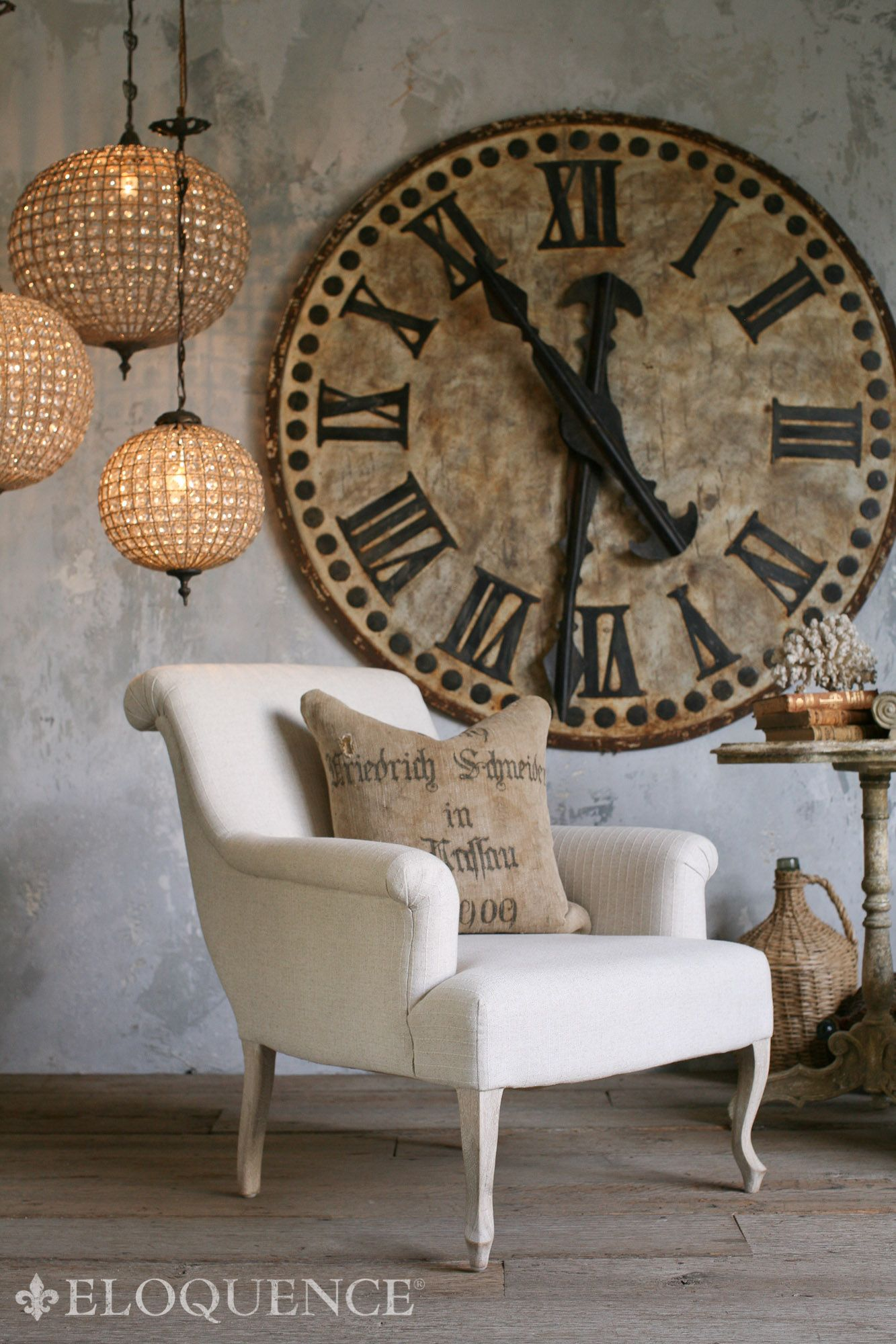 Oversize clock limewash walls burlap pillow linen chair in