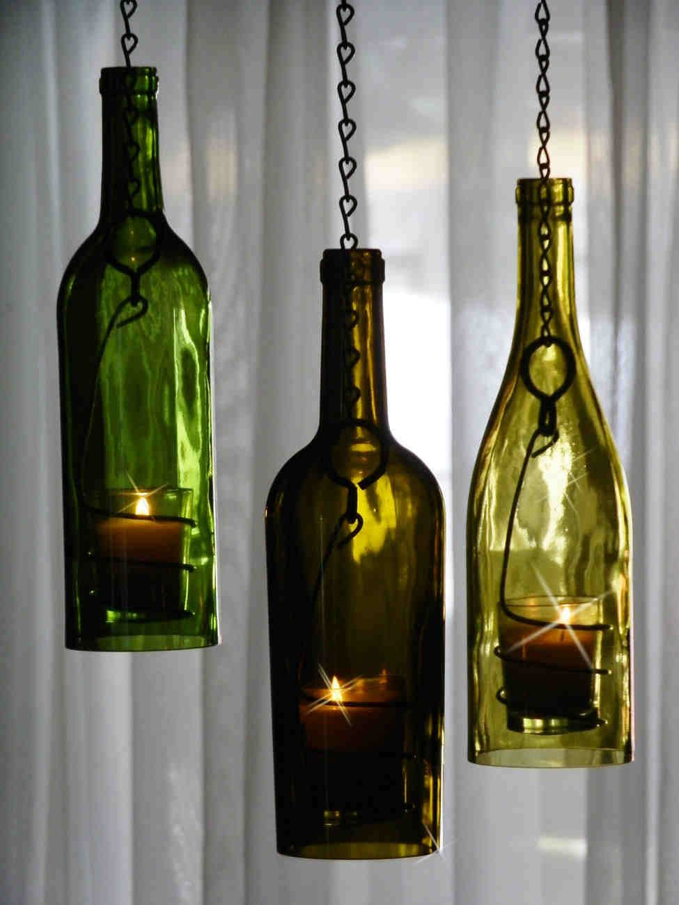 Diy wine bottle candle holders pretty cool diy for Champagne bottle candle holders