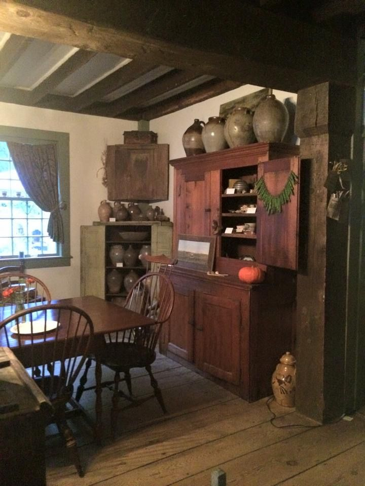 Red Prim Cupboard Crocks And Windsor Style Chairs Get The Look Primitive Dining Rooms Colonial Dining Room Primitive Decorating Country