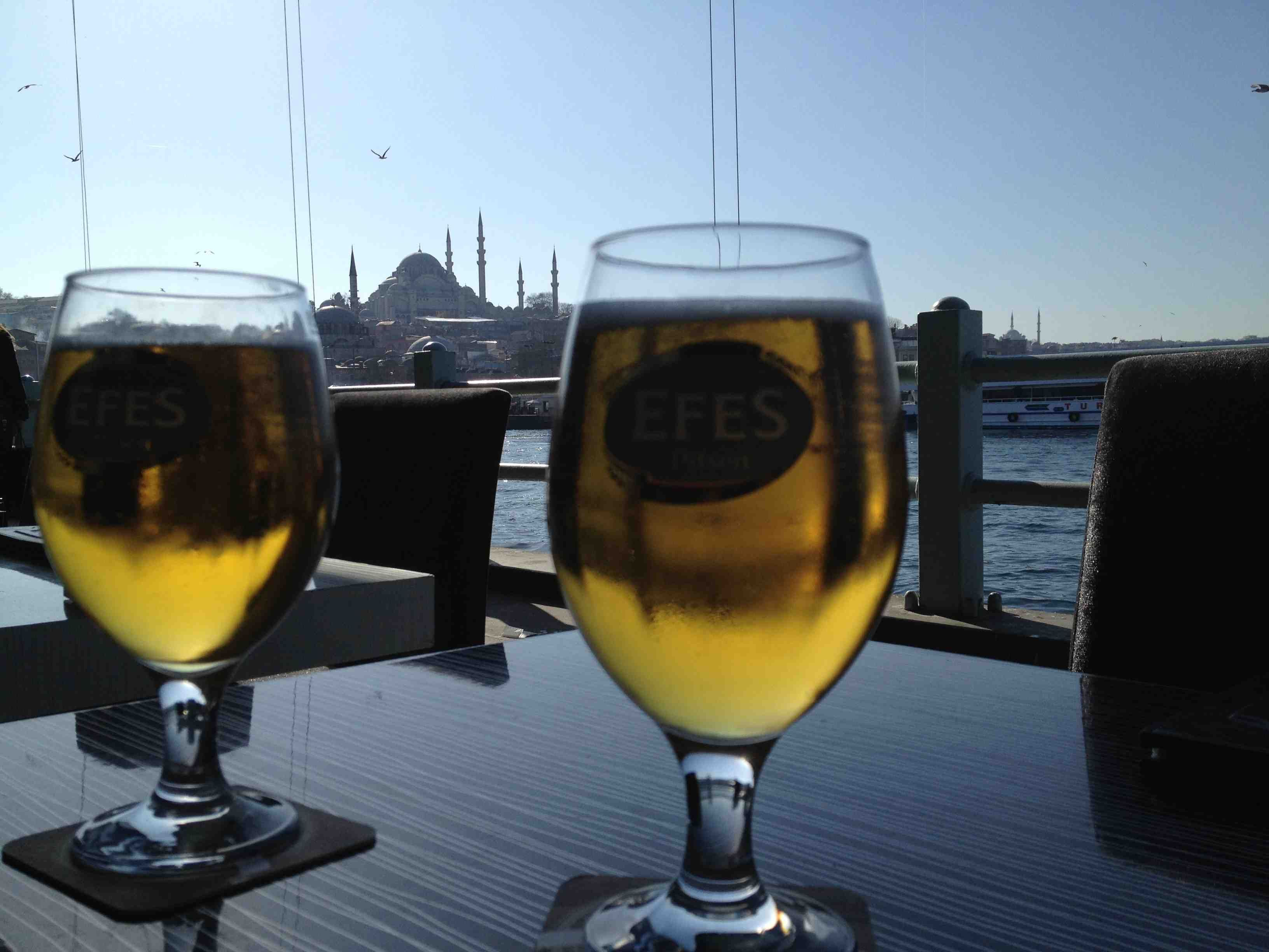 Having an Efes beer and Sultanahmet in the background