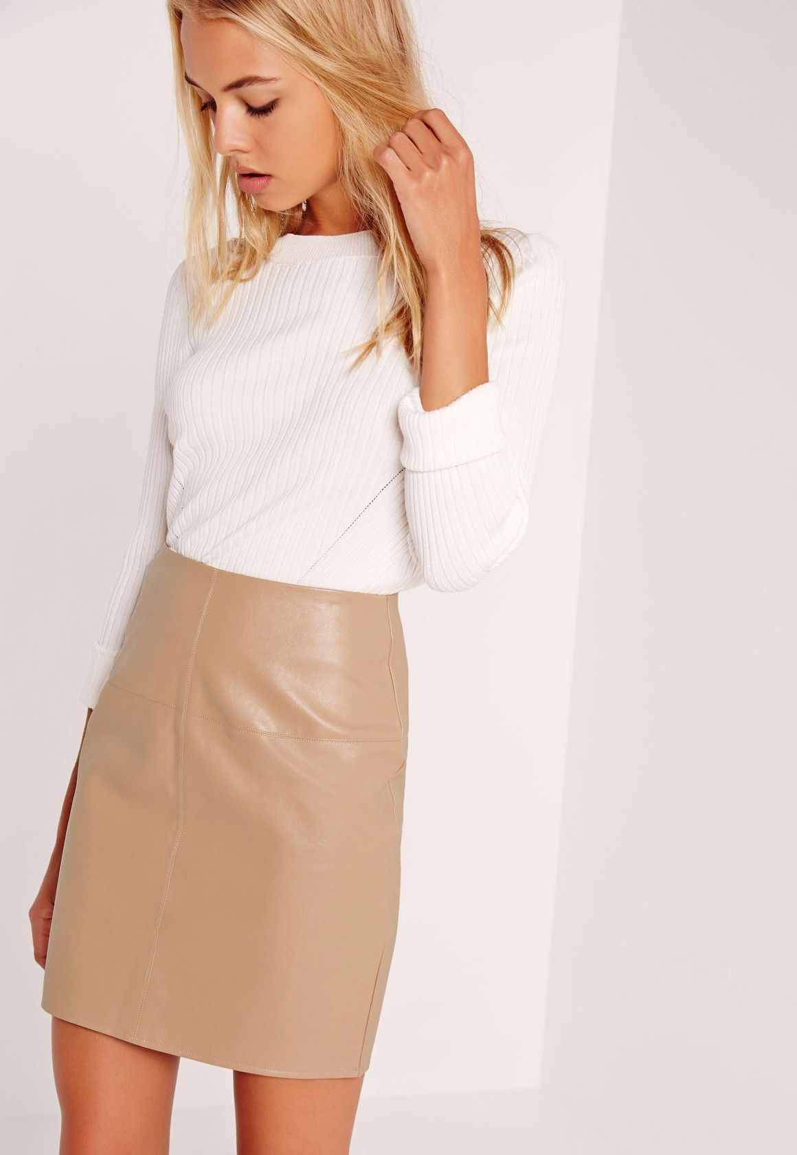 b23e57f2a Get set to look asspirational in this classic mini skirt. In a neutral tan  hue