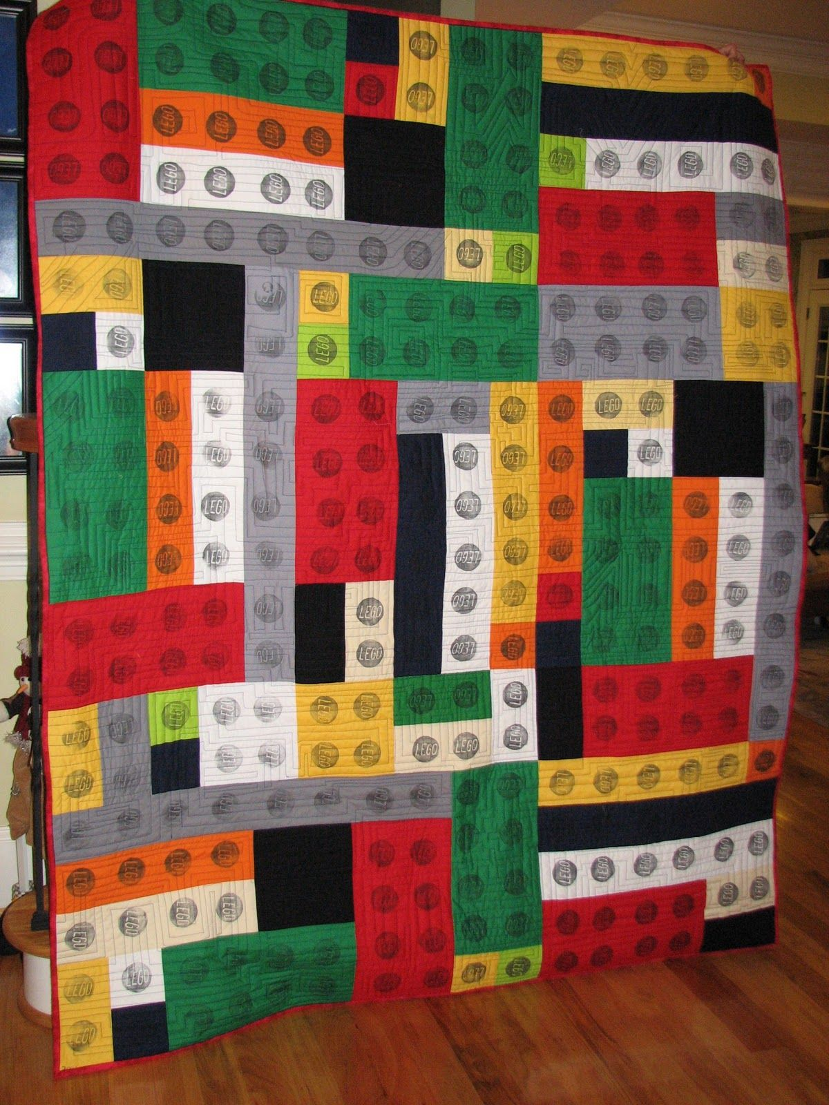 The crafty quilter 39 s closet lego quilt quilts for Quilt material for boys