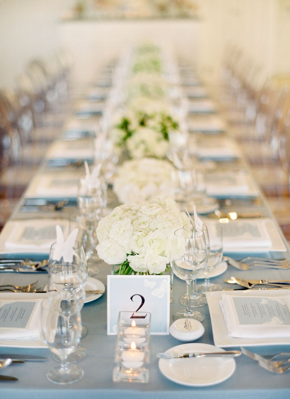 light blue tablecloth, white centerpieces, long table | Reception ...
