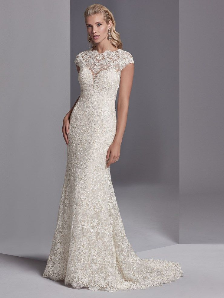 This boho wedding gown features allover lace motifs in a sheath silhouette 70d04c32b