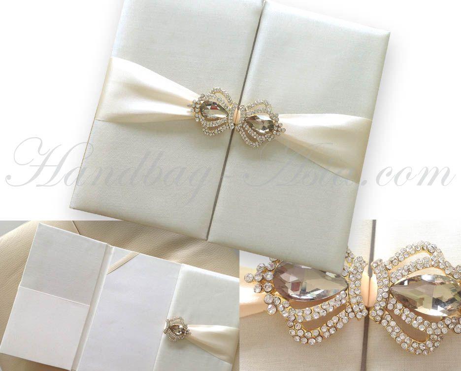 Planning the next wedding? Ivory silk folio & crown brooch ...