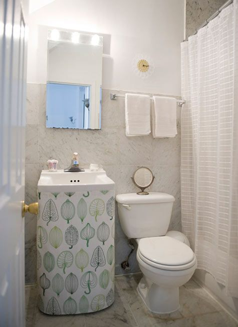fabric skirt around sink to hide pipes and create storage space