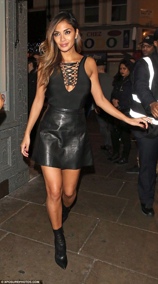 Nicole Scherzinger Teams Plunging Lace Up Top With Leather Mini Skirt