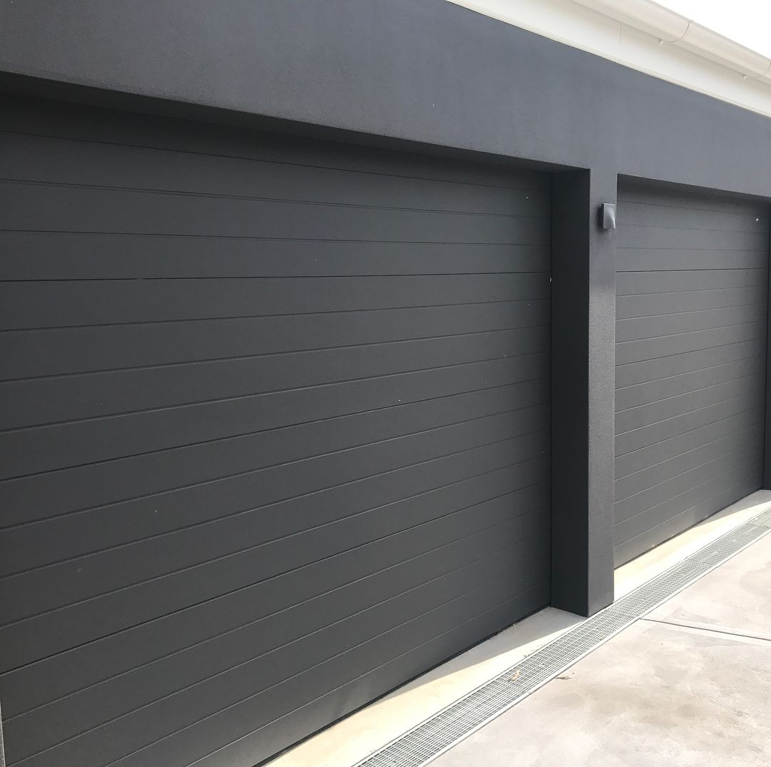 Danmar Scyon Axon Clad Panel Scyonwalls Is Becoming One Of The Most Widely Used Types And Styles Of Cl Garage Door Design Garage Doors Modern Garage Doors