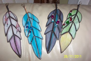 Stained glass feathers with glass beads. Created by CKohn. These feathers I added a strip of leather around the wire - sprayed with adhesive glue and then added glass beads.