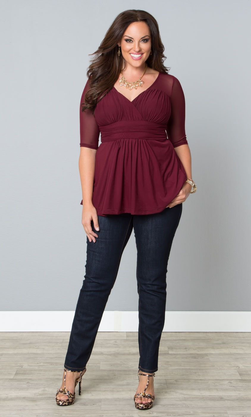 A beautiful burgundy top, like our plus size Inspired Illusion Mesh Top, paired with jeans and leopard print is a must this season! www.kiyonna.com #KiyonnaPlusYou #Kiyonna #Fall
