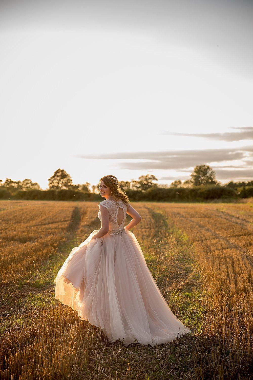 Katherine Ashdown Photography - Stella York Wedding Dress   The Red Barn Norfolk   Pastel Colour Scheme   White Bridesmaid Dresses   Katherine Ashdown Photography   Studio Media Films   http://www.rockmywedding.co.uk/charlotte-barry/