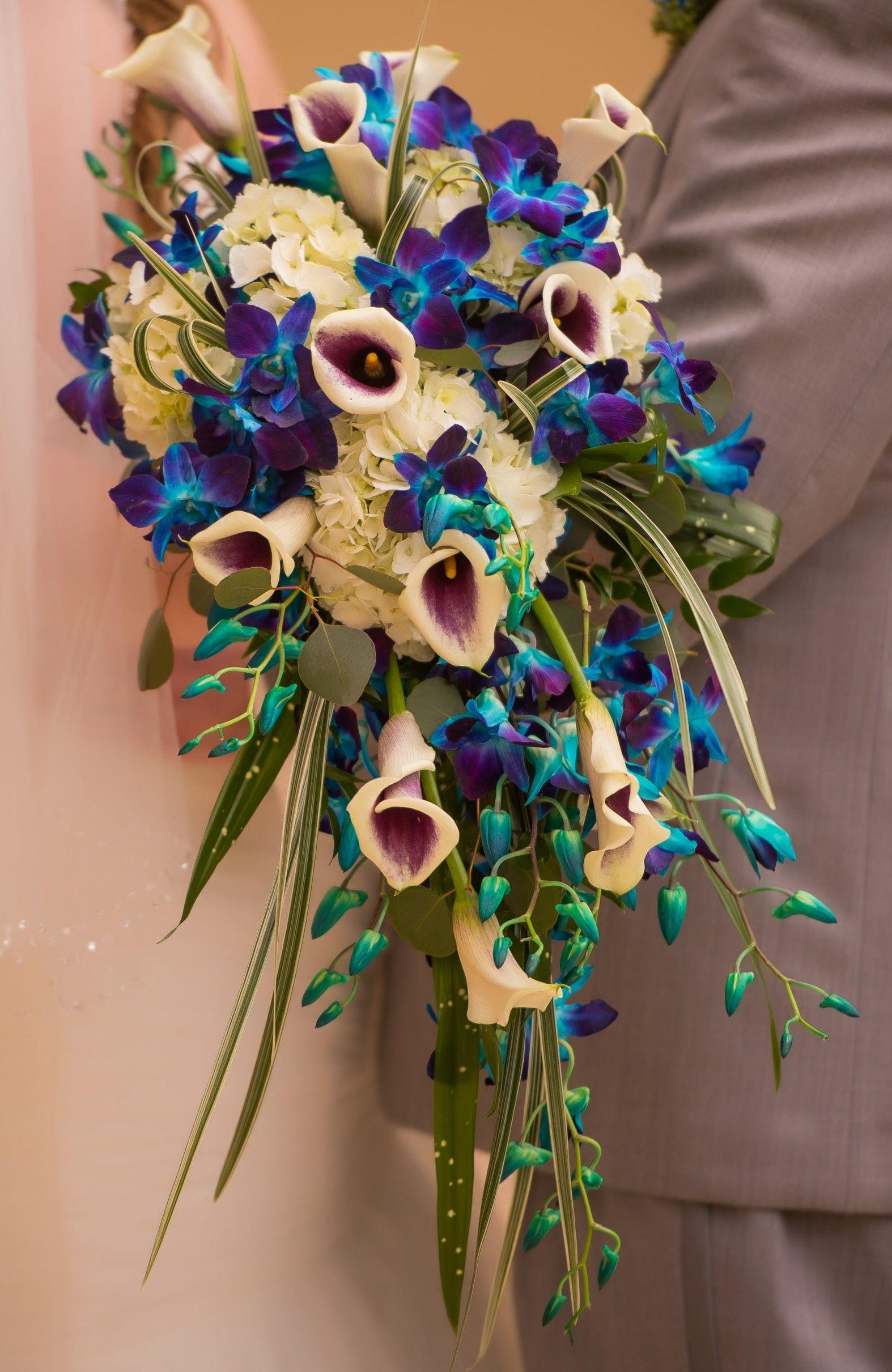 cascading bouquet - blue dendrobium orchids, picasso calla lilies, and white hydrangeas
