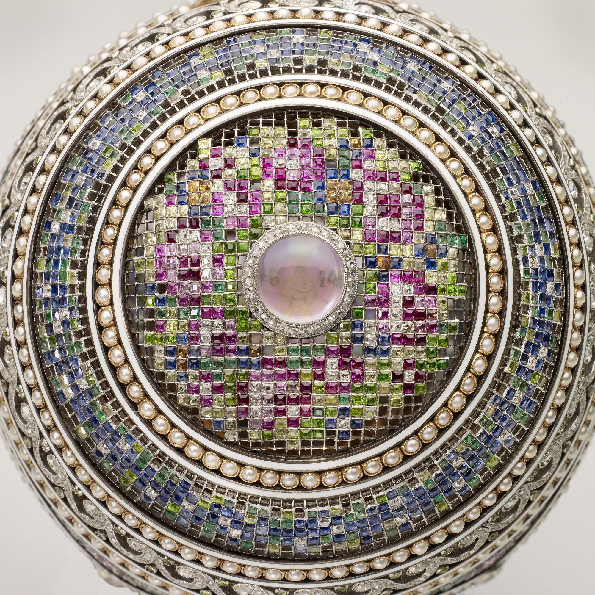 Top detail of the imperial mosaic egg easter 1914 faberge eggs one of the most sophisticated of fabergs imperial eggs is the mosaic egg the tsars 1914 easter gift to his wife the tsarinas monogram and are set negle Images