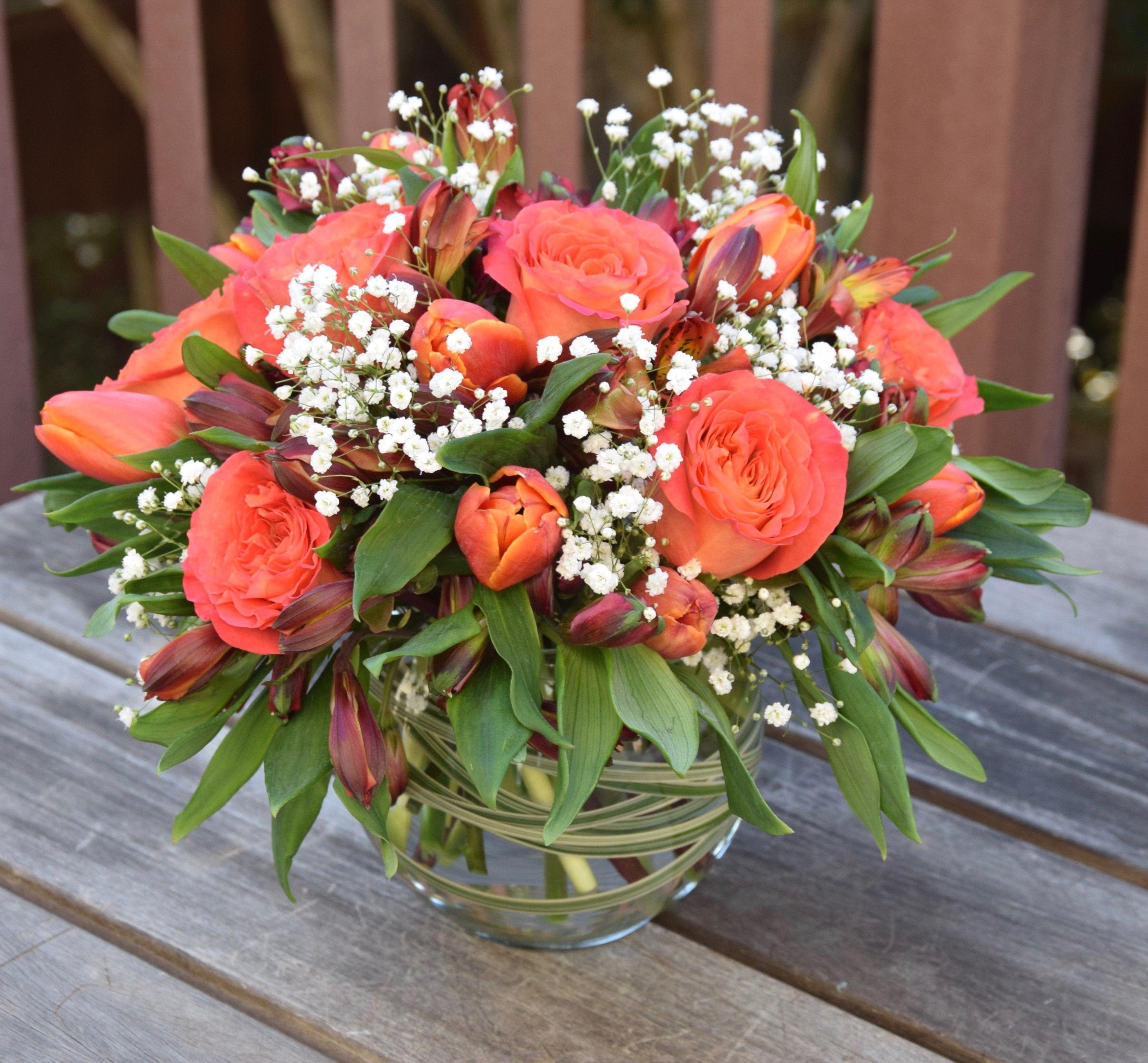 Flower arrangement with roses, tulips, alstroemerias, baby