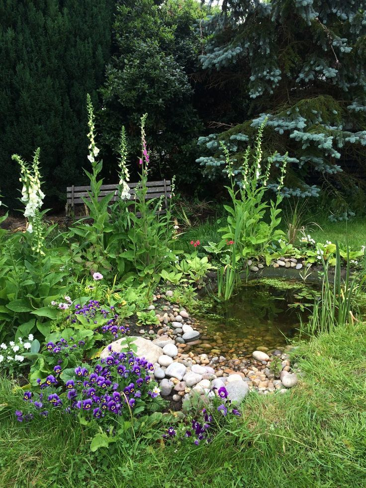 a small backyard pond as a water feature. Great idea for wildlife garden and tra #waterfeatures