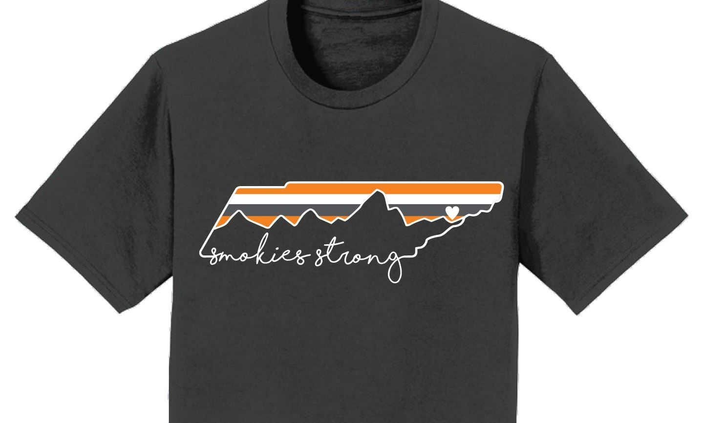 """The charcoal grayshirts are $15 each and feature an image of Tennessee, the Smoky Mountains, a heart, and the""""SmokiesStrong"""" message."""