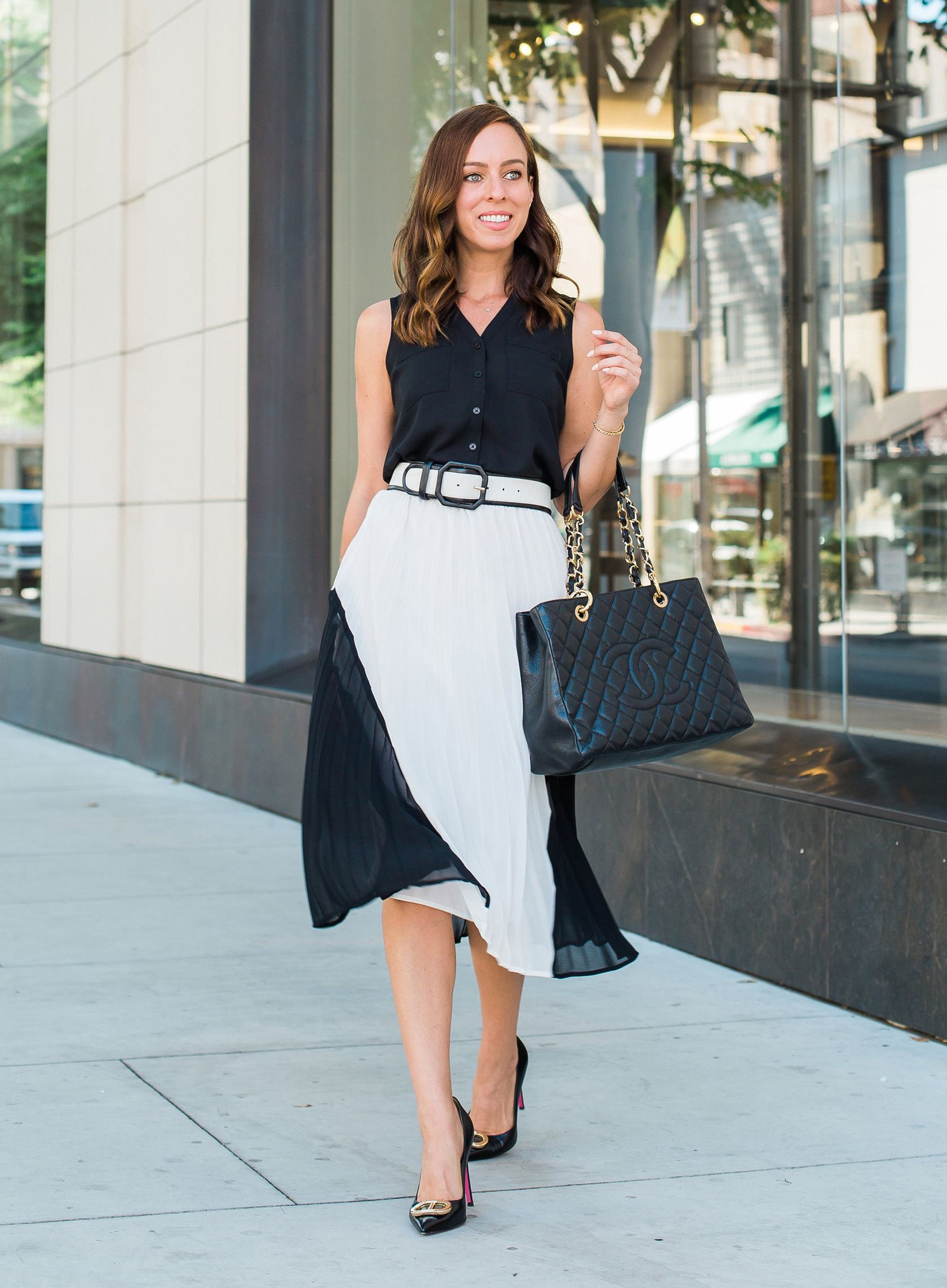 81634289aee7 Sydne Style shows easy office outfit ideas in pleated skirt and black pumps  #blackandwhite #skirts #chanel #chanelbag #meghanmarkle